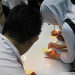 After the candles, attendees were invited to write messages on Post-It notes to the families of the deceased.