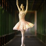 A member of the Beijing Dance Academy goes en pointe in the legendary Long Hallway of the Summer Palace in Beijing.