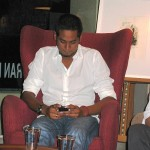 Khairy could not resist fondling his Blackberry during the event.